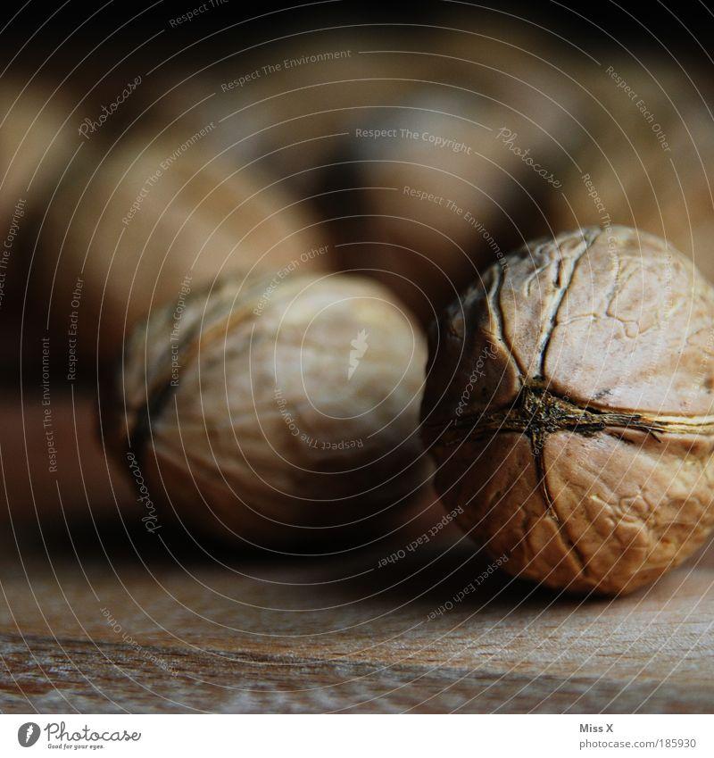 Happy Birthday Photocase! Lebensmittel Öl Ernährung Kaffeetrinken Abendessen Büffet Brunch Gesundheit klein listig braun Nuss Nussschale Walnuss brechen