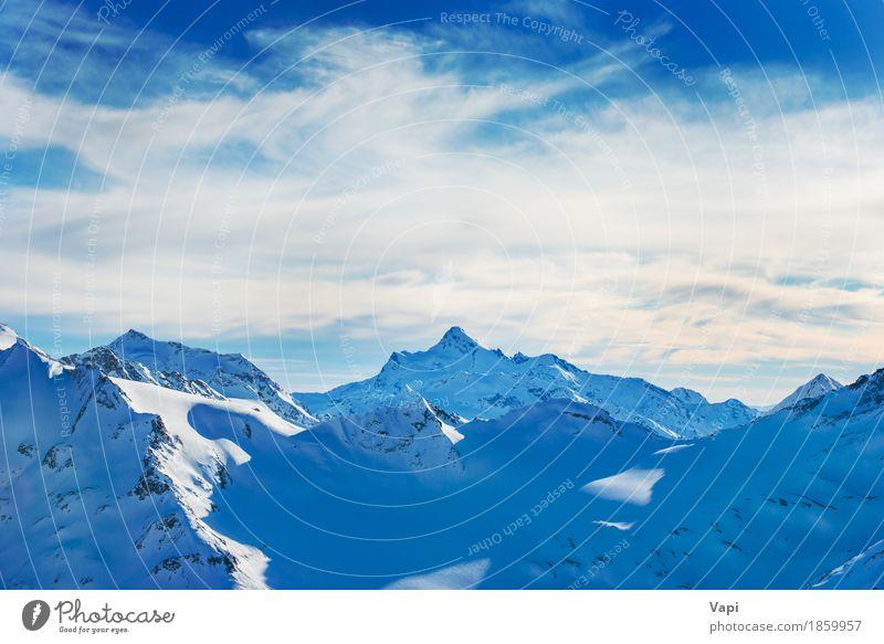 Schöner Sonnenuntergang in den Bergen Himmel Natur Ferien & Urlaub & Reisen blau schön weiß Landschaft Wolken Winter Berge u. Gebirge gelb Sport Schnee Felsen