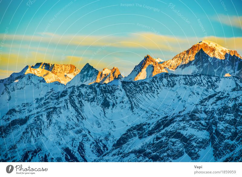 Sonnenuntergang in den weißen Bergen mit Schnee Himmel Natur Ferien & Urlaub & Reisen blau schön Landschaft rot Wolken Winter Berge u. Gebirge gelb Sport Felsen
