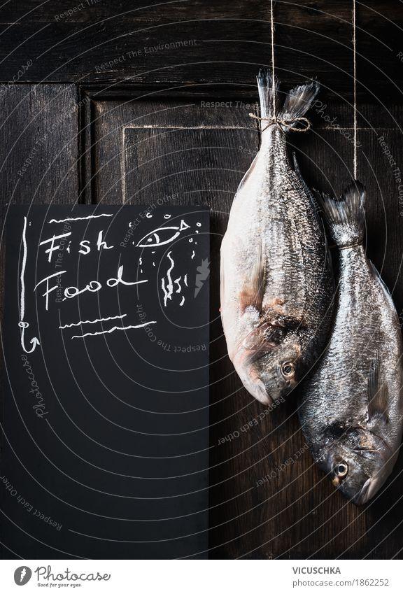 Zwei Dorado Fische hängen am Seil Lebensmittel Ernährung Vegetarische Ernährung Diät Stil Design Gesunde Ernährung Küche Restaurant Essen Essen zubereiten