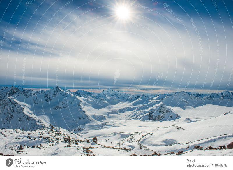 Sonnenuntergang in den blauen Bergen des Winters mit Wolken Himmel Natur Ferien & Urlaub & Reisen weiß Landschaft Berge u. Gebirge schwarz gelb Sport Schnee