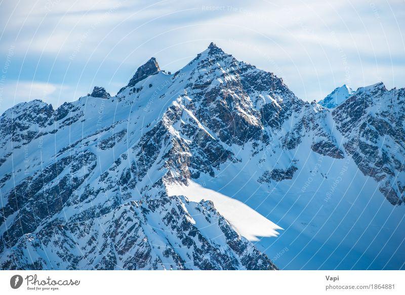 Blaue Bergspitzen Snowy in den Wolken Himmel Natur Ferien & Urlaub & Reisen blau schön weiß Landschaft Winter Berge u. Gebirge schwarz Sport Schnee Felsen