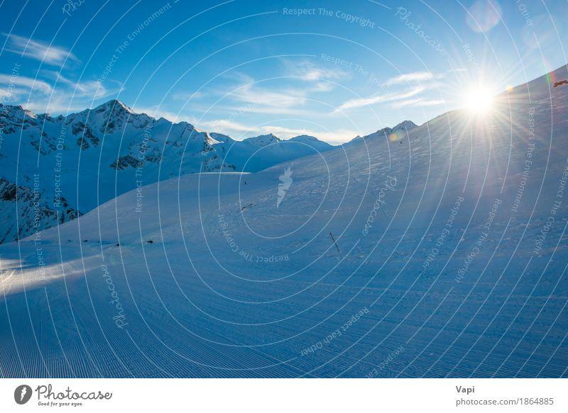 Blaue Berge Snowy in den Wolken bei Sonnenuntergang Himmel Natur Ferien & Urlaub & Reisen blau weiß Landschaft Winter Berge u. Gebirge gelb Sport Schnee Felsen
