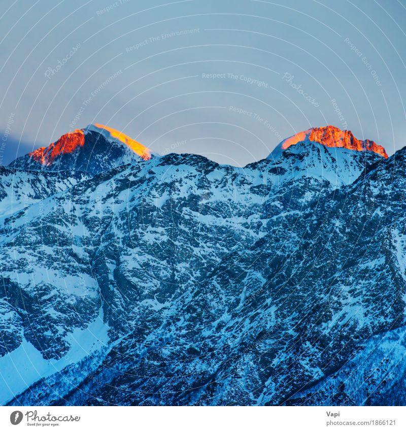 Roter Sonnenuntergang auf Bergspitzen Himmel Natur Ferien & Urlaub & Reisen blau weiß Landschaft rot Wolken Winter Berge u. Gebirge Umwelt gelb Schnee Felsen