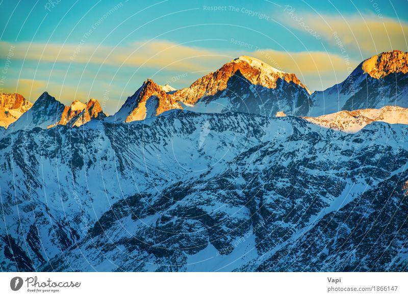 Schöner Sonnenuntergang in den Bergen Himmel Natur Ferien & Urlaub & Reisen blau weiß Landschaft rot Wolken Winter Berge u. Gebirge schwarz gelb Schnee Felsen