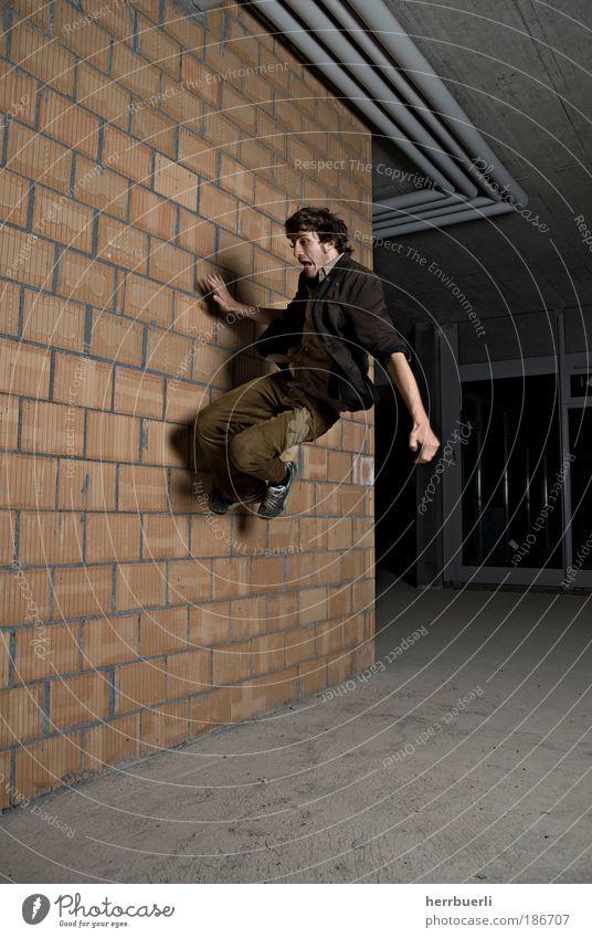 Baustell Fashion Mensch Mann Jugendliche Erwachsene Leben Architektur grau springen Kunst braun Tanzen maskulin wild verrückt Unendlichkeit