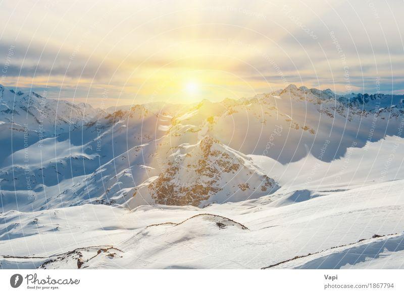 Sonnenuntergang in den schneebedeckten blauen Bergen mit Wolken Himmel Natur Ferien & Urlaub & Reisen weiß Landschaft rot Winter Berge u. Gebirge schwarz gelb