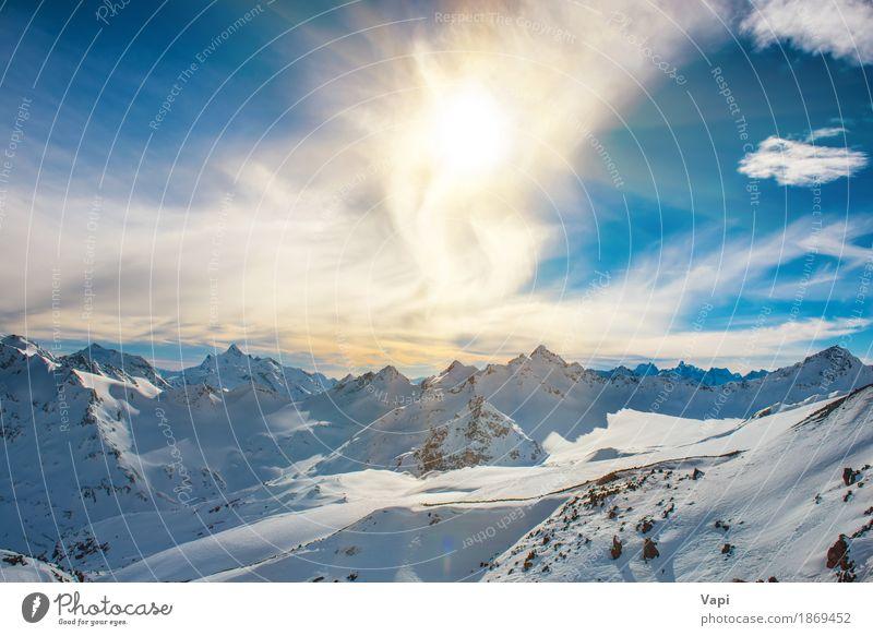 Sonnenuntergang in den schneebedeckten blauen Bergen mit Wolken Himmel Natur Ferien & Urlaub & Reisen weiß Landschaft Winter Berge u. Gebirge schwarz gelb