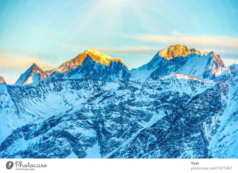 Sonnenuntergang in Bergen Himmel Natur Ferien & Urlaub & Reisen blau weiß Landschaft rot Wolken Winter Berge u. Gebirge schwarz gelb Schnee Felsen Tourismus