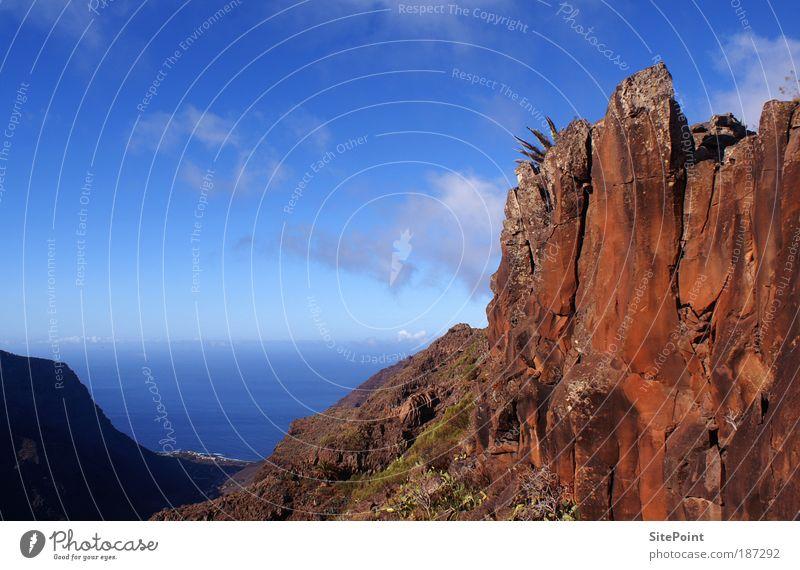 Wie im Wilden Westen Wasser Himmel Meer blau rot Wolken Ferne Berge u. Gebirge Stein Landschaft Horizont Felsen Insel