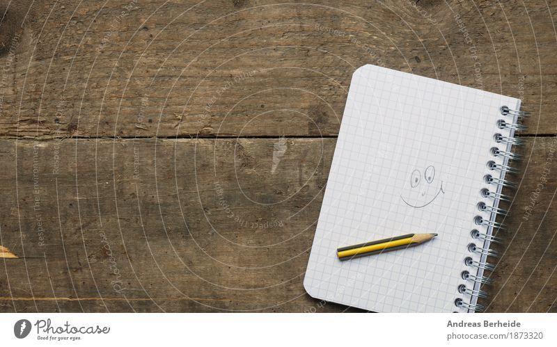 Ein Lächeln Zufriedenheit Schreibtisch Büro Business Musiknoten Printmedien Papier Zettel Schreibstift Fröhlichkeit book paper table spiral Hintergrundbild