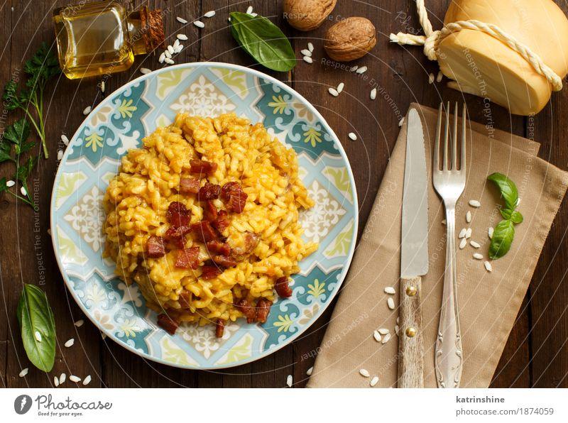 Risotto mit einem Kürbis und einem Speck blau Speise gelb Holz hell Ernährung Kräuter & Gewürze kochen & garen lecker Gemüse Getreide Teller Schalen & Schüsseln