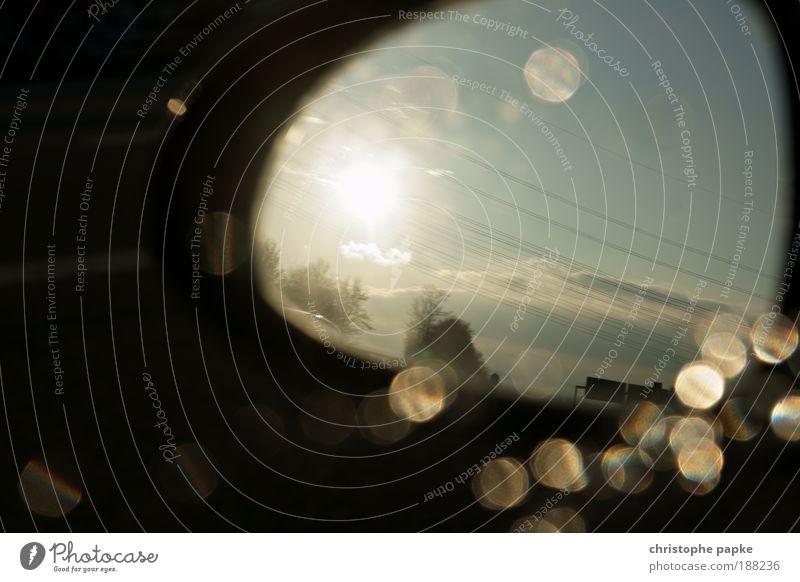 Rückblickend aufs alte Jahr schön Himmel Sonne PKW Straßenverkehr Wassertropfen ästhetisch fahren Spiegel Autobahn Autofahren Blick Hochspannungsleitung