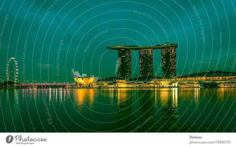 Singapur Hauptstadt Skyline Hochhaus Hotel Turm Bauwerk Gebäude Architektur Sehenswürdigkeit glänzend Beleuchtung leuchten Lampe Kitsch Singapore Nachtaufnahme