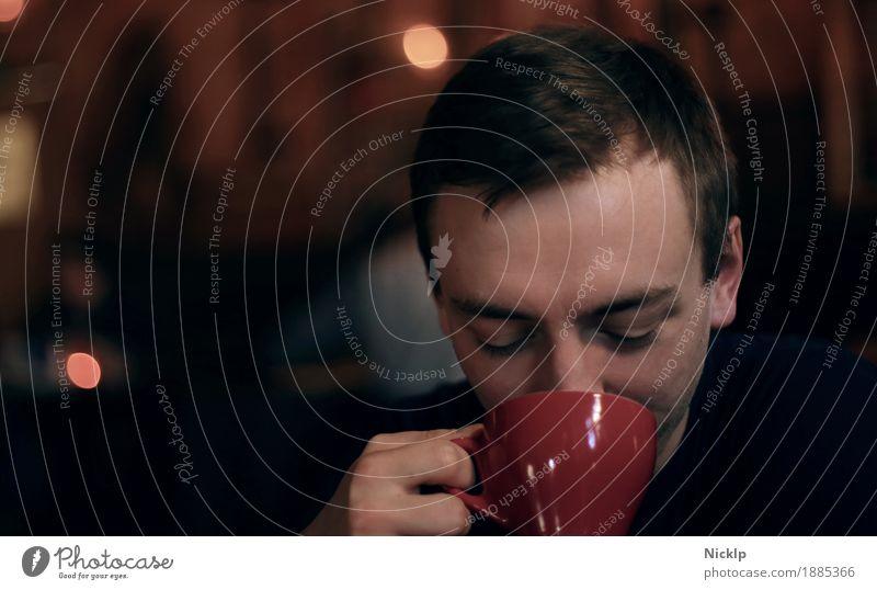 Handsome young caucasian male drinking from a red cup Mensch Jugendliche Mann blau Junger Mann rot Erholung ruhig 18-30 Jahre Erwachsene Wärme Lifestyle braun maskulin Zufriedenheit 13-18 Jahre
