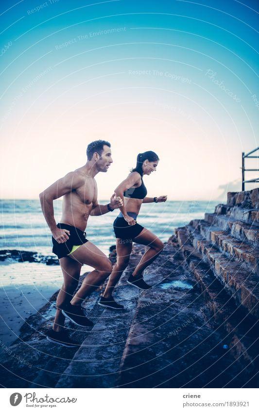 Mensch Jugendliche blau Junge Frau Junger Mann Strand 18-30 Jahre Erwachsene Lifestyle Sport Paar Wellen Fitness sportlich Partnerschaft Sport-Training