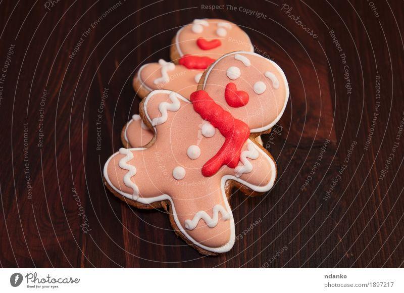 Essbarer Lebkuchenmann zwei, Draufsicht Mann Weihnachten & Advent Winter Erwachsene Holz klein Feste & Feiern Paar braun rosa Dekoration & Verzierung Aussicht