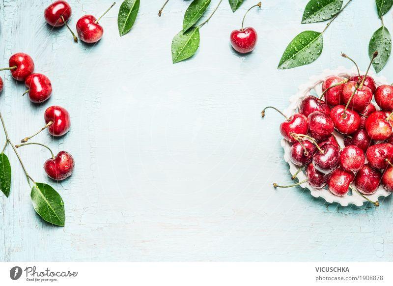 Kirschen in der Schüssel mit Zweigen und Blättern Lebensmittel Frucht Ernährung Bioprodukte Lifestyle Stil Design Gesundheit Gesunde Ernährung Sommer Tisch