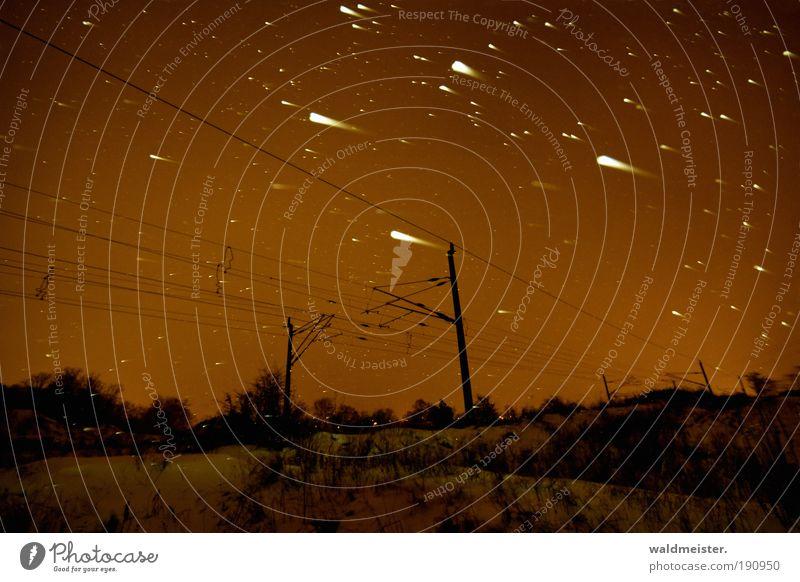 Sternhagel Ferien & Urlaub & Reisen kalt Schnee Schneefall Stern Eisenbahn Nacht Zeit bedrohlich Weltall Langzeitbelichtung unheimlich Energie Oberleitung Sternschnuppe fahren