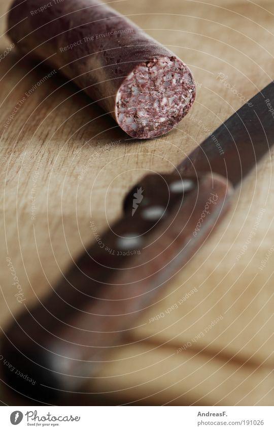 Alles hat ein Ende... Lebensmittel Fleisch Wurstwaren Ernährung Messer Küche Holz lecker grützwurst blutwurst Vesper Schneidebrett Metzger Metzgerei Farbfoto