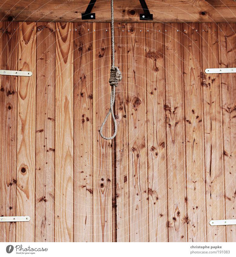 Hangover Tod Wand Holz Mauer Angst Fassade Seil bedrohlich Vergänglichkeit USA historisch skurril Todesangst Stress hängen Verzweiflung