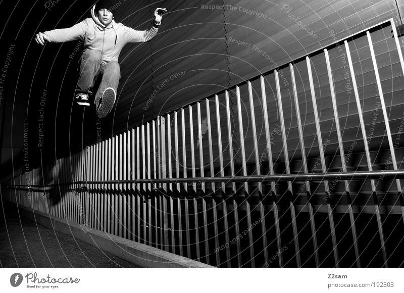 rückwärts Lifestyle elegant Stil Mensch maskulin 18-30 Jahre Jugendliche Erwachsene Gebäude Architektur Mauer Wand Jeanshose Pullover Mütze Bewegung fallen