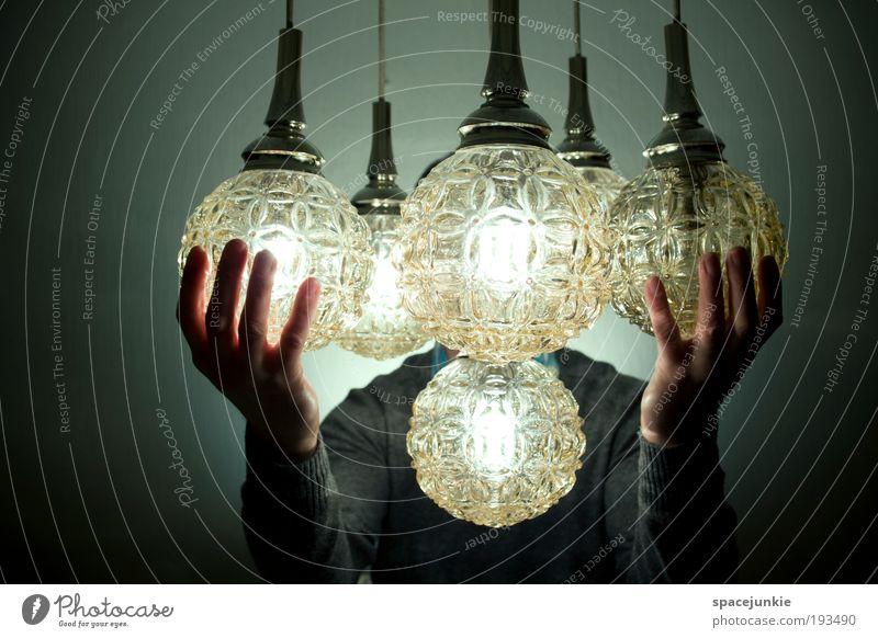 mystical lights Mensch Mann Hand Sonne Erwachsene Bewegung Lampe Glas Stern maskulin berühren Zusammenhalt hängen Pullover Natur Umarmen