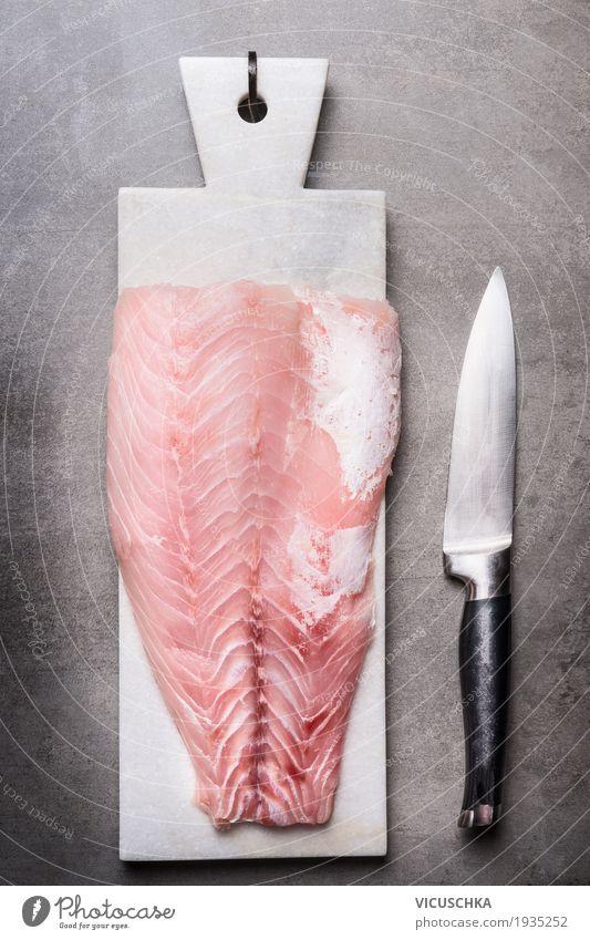 Rotbarschfilet auf Schneidebrett mit Messer Lebensmittel Fleisch Ernährung Vegetarische Ernährung Diät Geschirr Stil Design Gesundheit Gesunde Ernährung Tisch