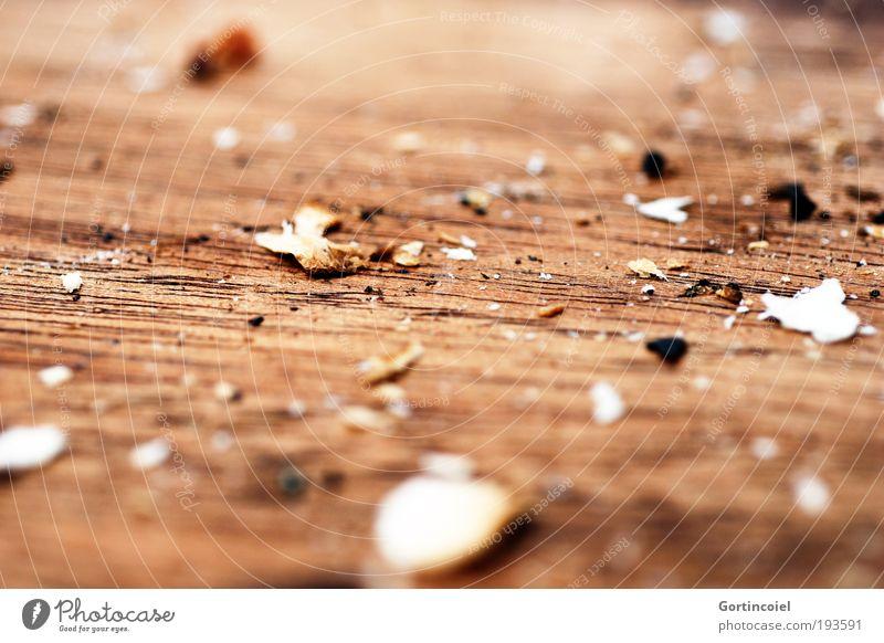 Satt braun trocken Holzbrett Rest Schneidebrett Holz Krümel Makroaufnahme Brotkrümel