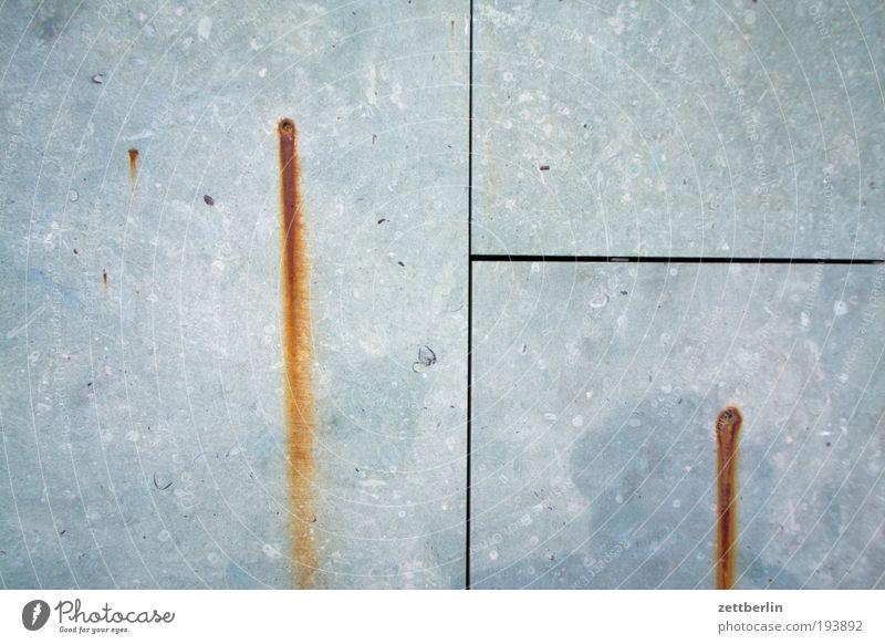 Rost Haus Stein Mauer Architektur Beton Spuren Geometrie Eisen Nagel Fuge Granit auslaufen Sediment ausbluten