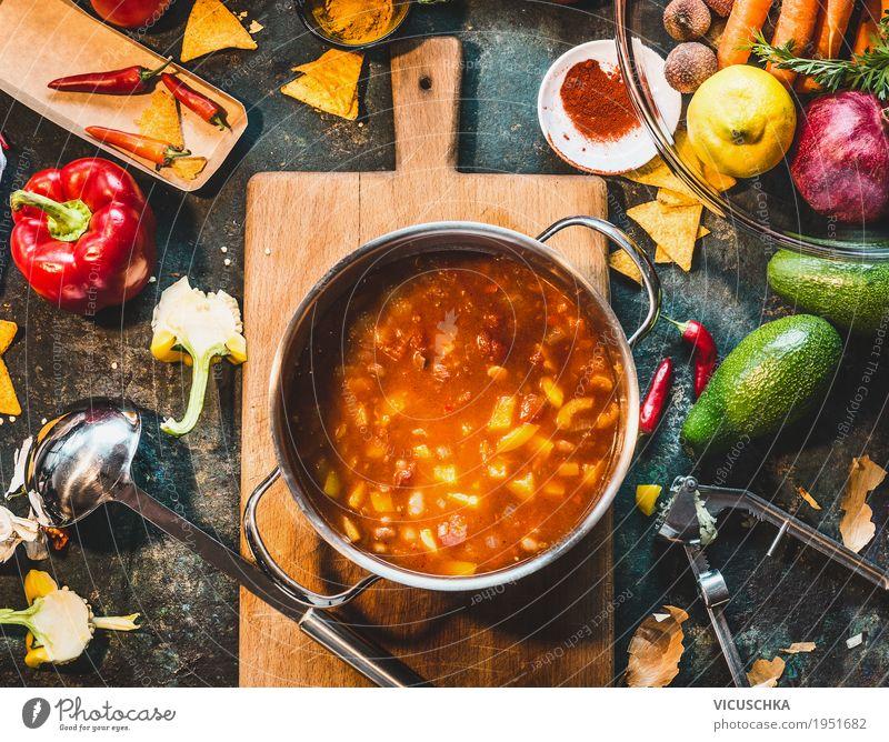 Kochtopf mit fliegendes gem se und kochl ffel ein for Mexikanisch kochen