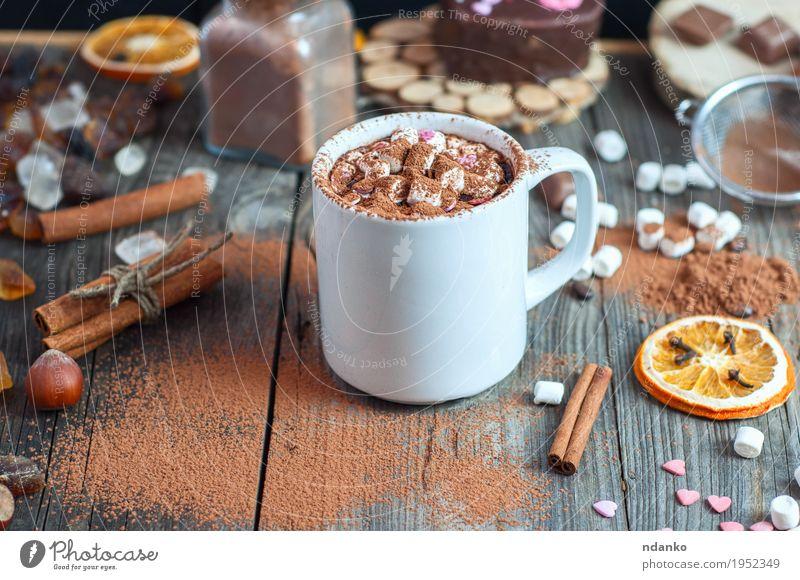 Tasse mit Marshmallow bestreut mit Kakaopulver Weihnachten & Advent Essen natürlich Holz Lebensmittel grau braun oben orange Frucht Tisch Getränk trinken lecker