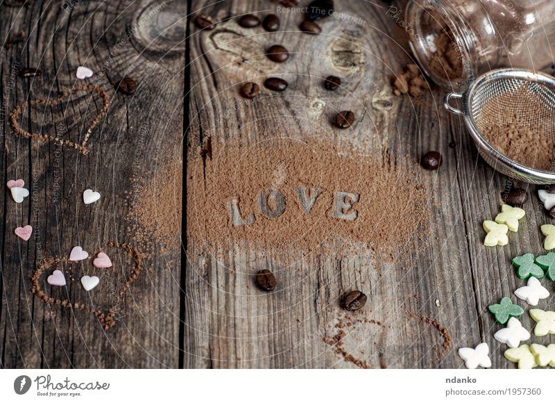 Wortliebe geschrieben auf die graue Holzoberfläche Lebensmittel Süßwaren Flasche Dekoration & Verzierung Tisch Natur Sieb Herz alt Liebe natürlich oben braun