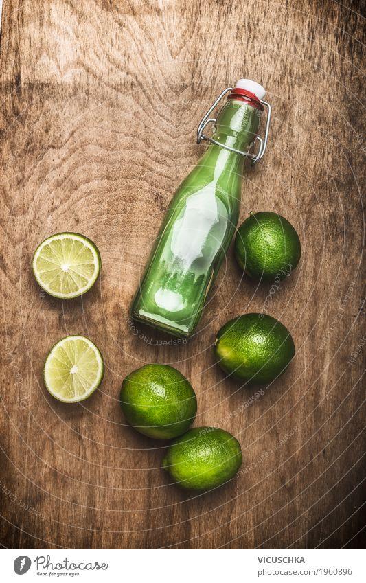 Flasche mit Limettensaft Lebensmittel Frucht Bioprodukte Vegetarische Ernährung Diät Getränk Saft Stil Design Gesundheit Gesunde Ernährung Sommer Tisch
