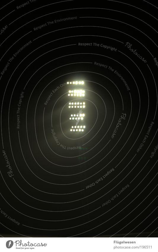 Thy word is a lamp unto my feet dunkel Lampe hell Kraft leuchten Laterne entdecken bizarr Sportveranstaltung Scheinwerfer blenden Stadion UFO Fußballplatz