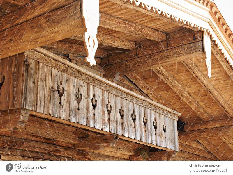 Viel Holz vor der Hütte Ferien & Urlaub & Reisen Haus Berge u. Gebirge Holz Herz Architektur Fassade Kitsch Alpen Dorf Idylle Balkon Hütte Handwerk Österreich