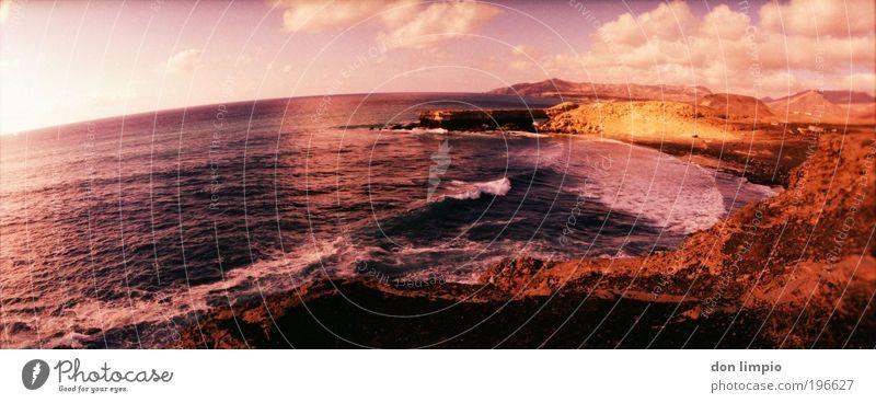 stone age2 Meer rot Sommer Strand Ferien & Urlaub & Reisen Wolken Ferne Landschaft Wellen Küste rosa Horizont Ausflug Insel rund Unendlichkeit