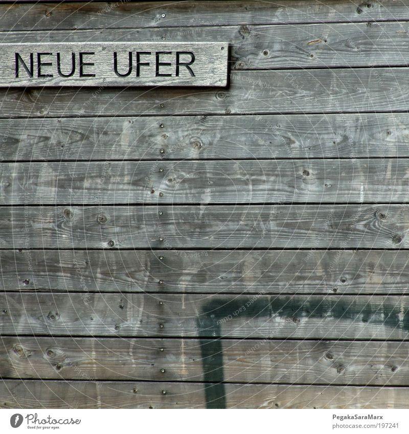 Neue Ufer II ruhig Wand Freiheit Holz grau Mauer Stimmung Zufriedenheit Schilder & Markierungen Beginn Erfolg Schriftzeichen neu Hoffnung einzigartig