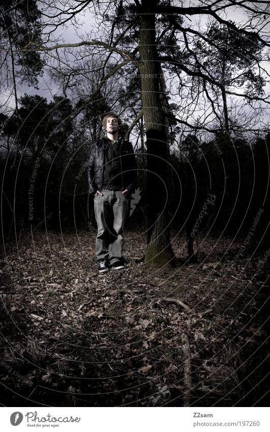 in the dark Mensch Natur Jugendliche Blatt Wolken Einsamkeit dunkel Umwelt Landschaft Stil stehen Jeanshose außergewöhnlich Ast gruselig Jacke