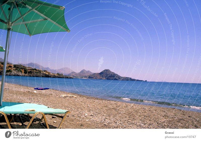 Beach Griechenland Kreta Strand Meer entfalten Ferien & Urlaub & Reisen lesen Liege Sonne Sonnenschirm heiß Brandung Luft salzig Wärme bequem Europa