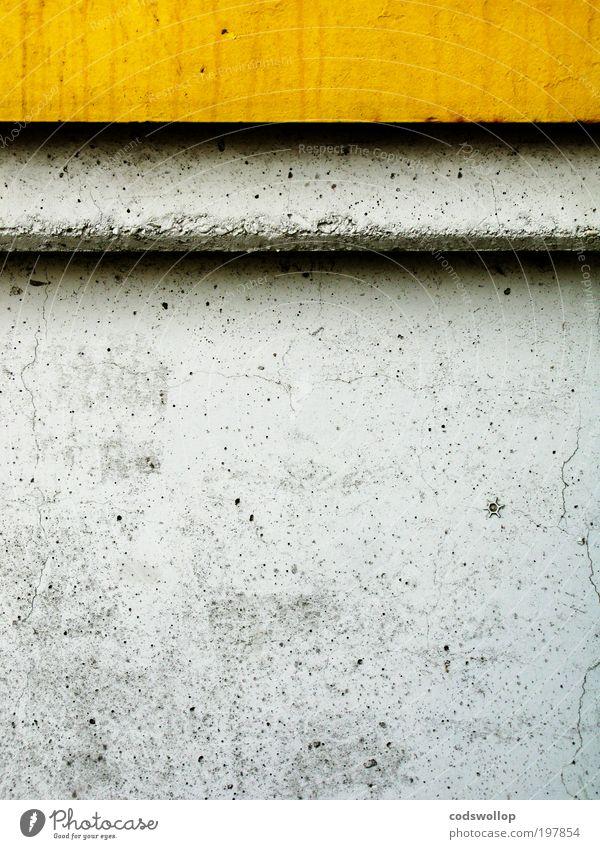 yellow grey black Bauwerk Mauer Wand Fassade Beton stark gelb grau schwarz Kraft Ziel Stern Blume Schatten Bordsteinkante Farbfoto Außenaufnahme Menschenleer