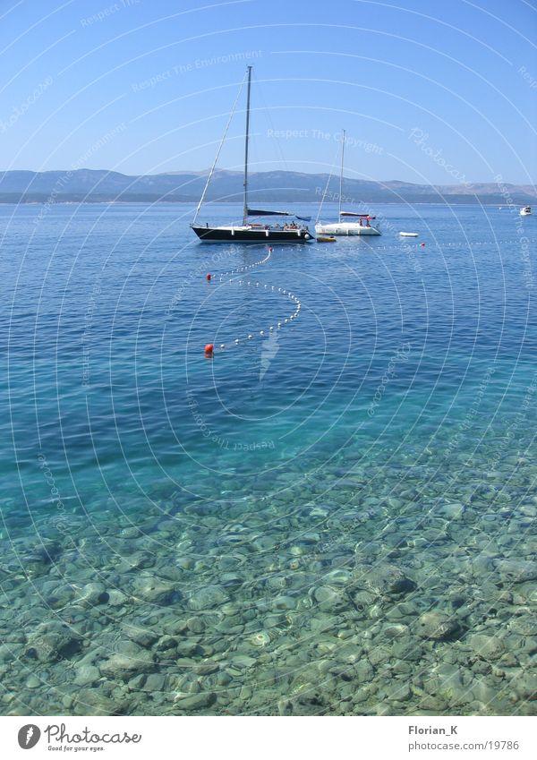Das Boot und das Meer blau Stein Wasserfahrzeug Klarheit