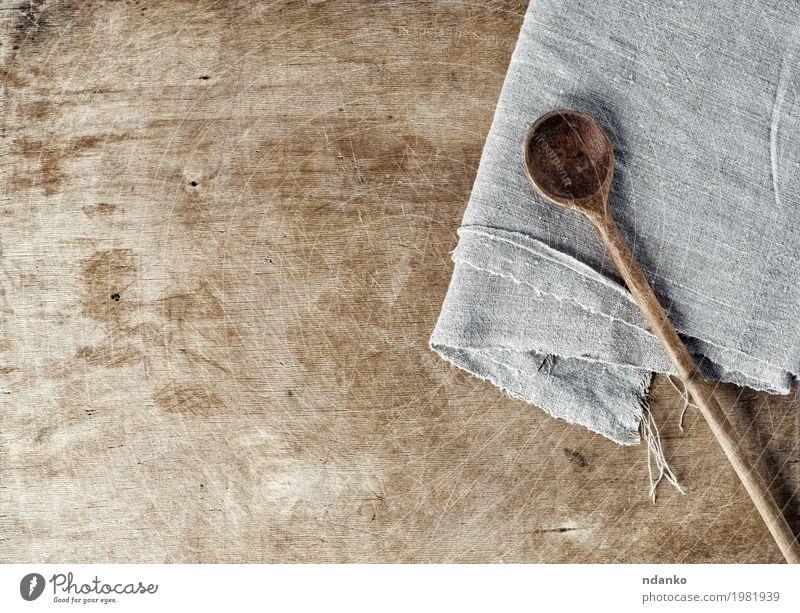 Hölzerner Hintergrund Browns mit einem hölzernen Löffel Tisch Küche Holz alt oben braun grau Koch Holzplatte Leerraum schäbig Haushaltswaren heimwärts Textil