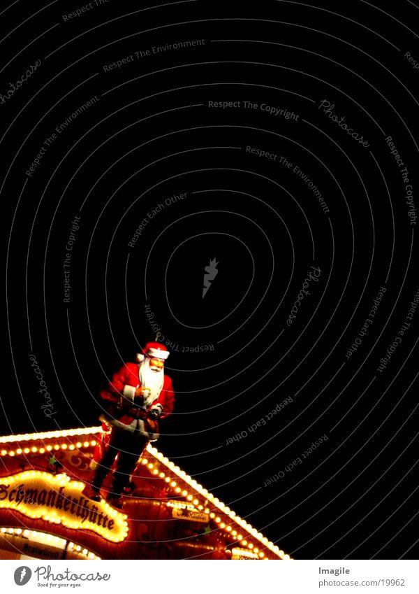 On kloanes Schmankerl Weihnachtsmann Weihnachtsmarkt Nacht Ernährung Weihnachten & Advent Hütte stehen