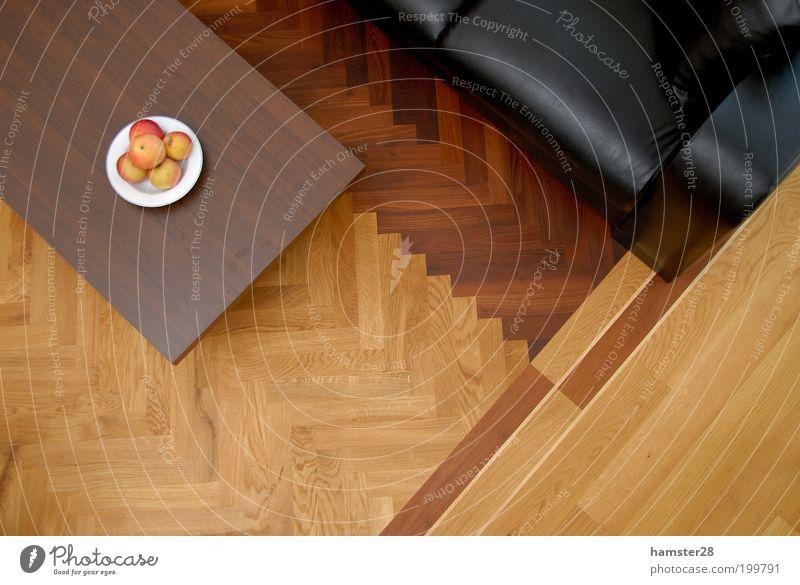 Parkett elegant Design Häusliches Leben Wohnung Traumhaus Innenarchitektur ästhetisch neu Fischgrätenmuster Frucht Apfel Obstschale Sofa Leder Ledersessel Tisch