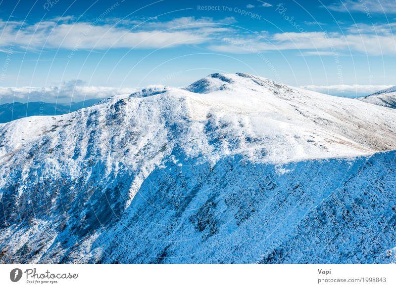 Weiße Gipfel der Berge im Schnee Himmel Natur Ferien & Urlaub & Reisen blau weiß Sonne Landschaft Wolken Winter Berge u. Gebirge gelb Tourismus Felsen wandern