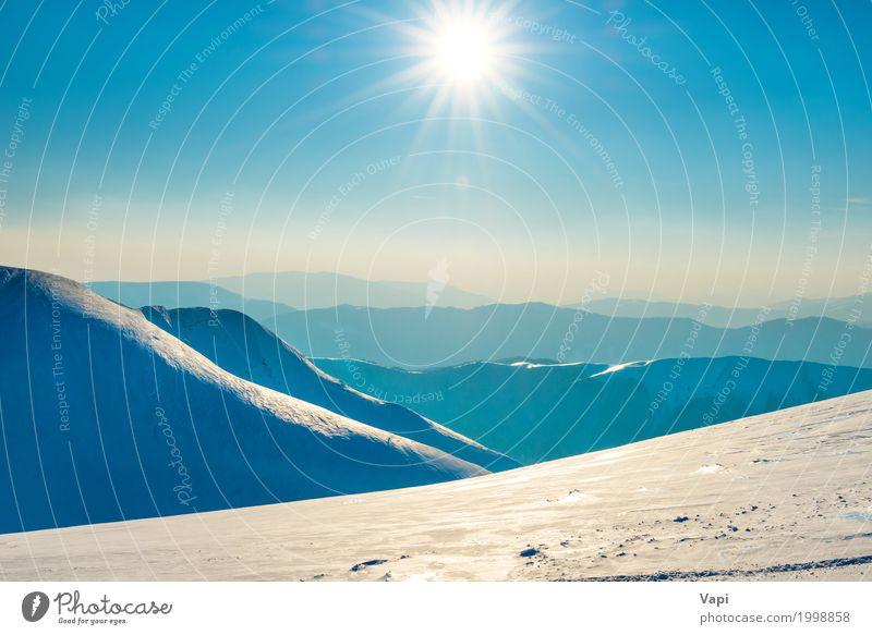 Helle Sonne in den Winterbergen Himmel Natur Ferien & Urlaub & Reisen blau weiß Landschaft Berge u. Gebirge Umwelt gelb natürlich Schnee orange Horizont Nebel