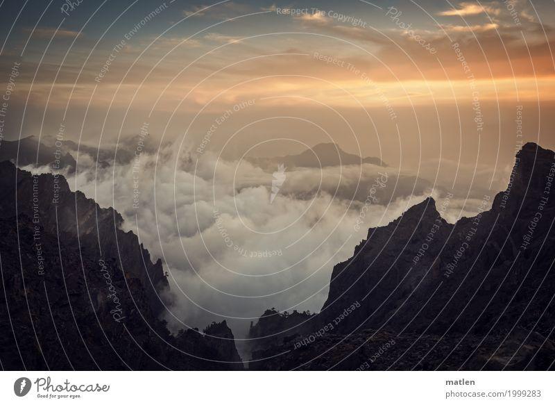 brodel Landschaft Wolken Sonnenaufgang Sonnenuntergang Schönes Wetter Felsen Berge u. Gebirge Gipfel Schlucht Unendlichkeit blau braun orange weiß Wolkenfeld