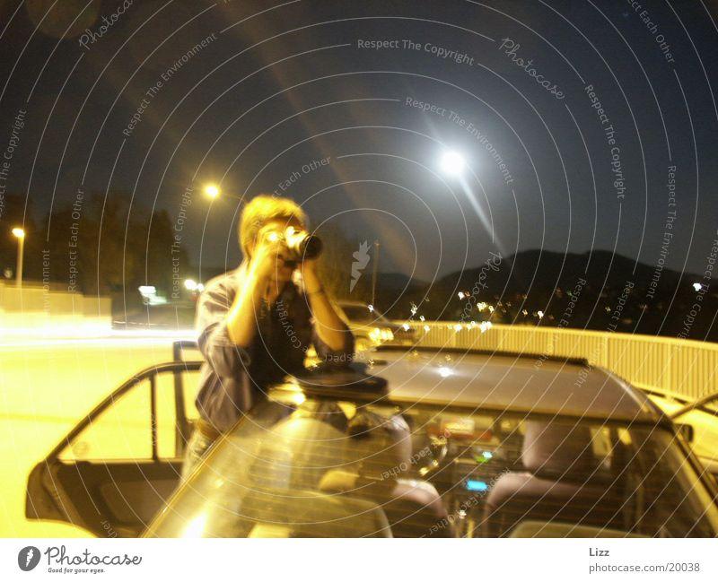 Nachtfotografierer Mann gelb Lampe Nachtaufnahme