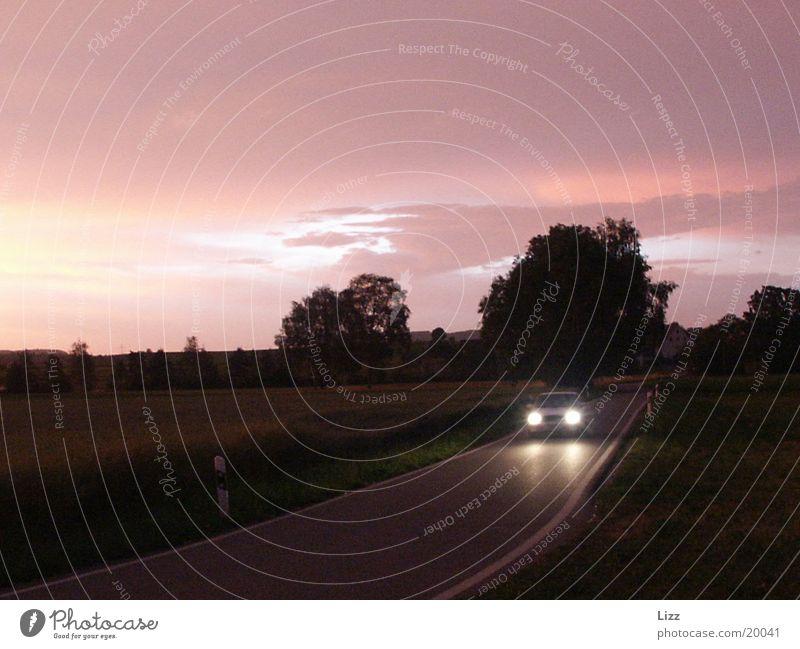 Nachtflitzer Gewitter Orangewolken Verkehr PKW Autolicht
